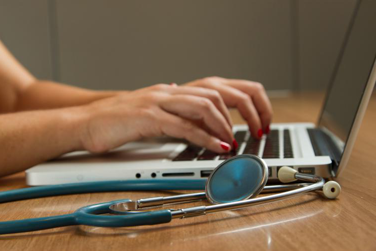 computer next to a stethoscope